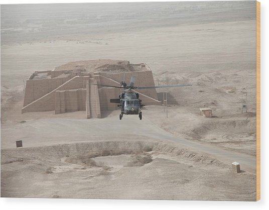 A Us Army Black Hawk Helicopter Hovers Wood Print by Everett