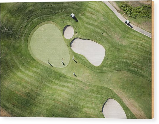 Aerial Of Golfers On Green Of Tierra Del Sol Golf Course Wood Print by Holger Leue