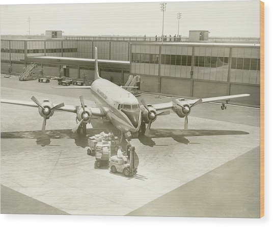 Airplane And Ground Crew On Airport Wood Print by George Marks
