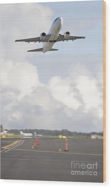 Airplane Taking Off Wood Print by Jaak Nilson