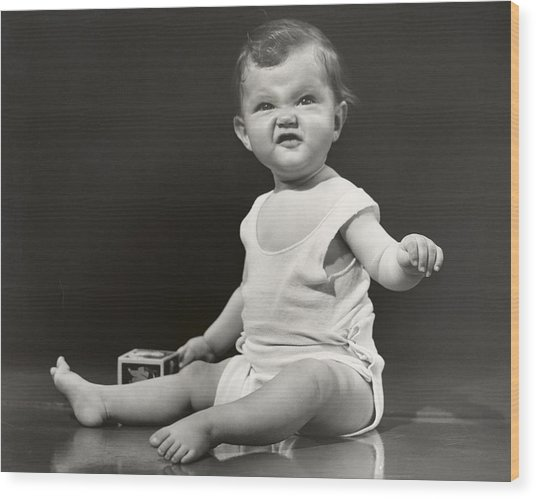 Baby Making Funny Face Wood Print by George Marks
