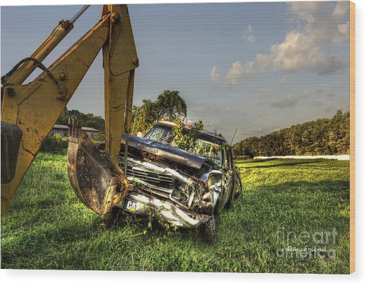 Backhoe Pulling Car Out Of Field Wood Print by Dan Friend