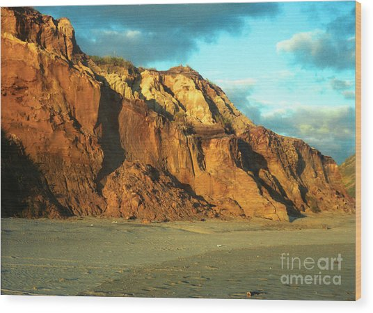 Beach Cliff At Sunset Wood Print