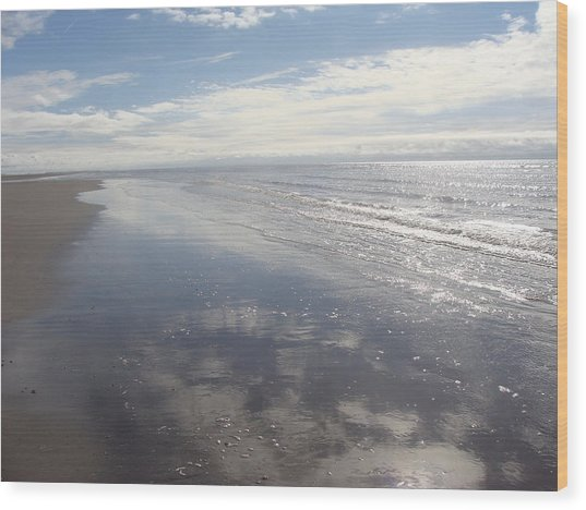Beach Clouds Wood Print by Emma Manners