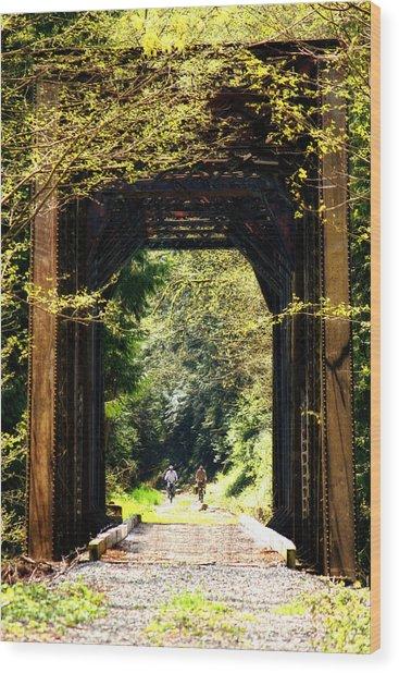 Bicycling Across Old Train Bridge Wood Print