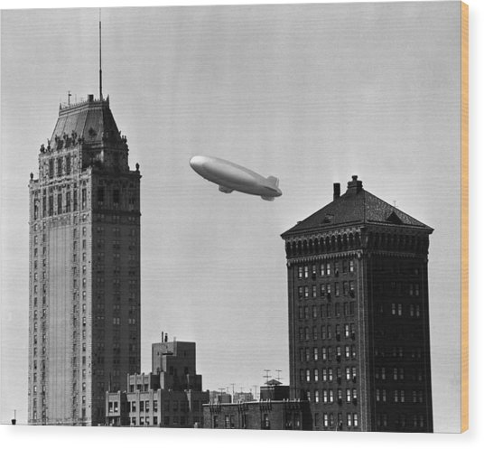 Blimp Over City Wood Print by George Marks