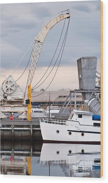 Boat And Old Crane Reflections Wood Print by David Lade
