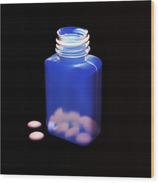 Bottle Of Pills, Negative Image Wood Print by Kevin Curtis