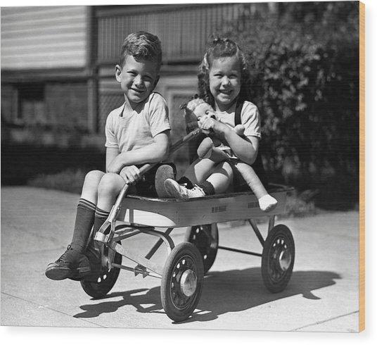 Boy & Girl On Wagon Wood Print by George Marks