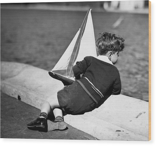 Boy Playing With Toy Sailboat Wood Print by George Marks