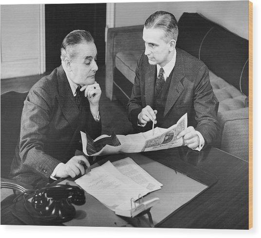 Businessmen Having A Meeting Wood Print by George Marks