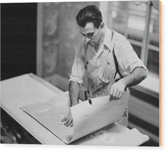 Carpenter Putting On Wallpaper Wood Print by George Marks
