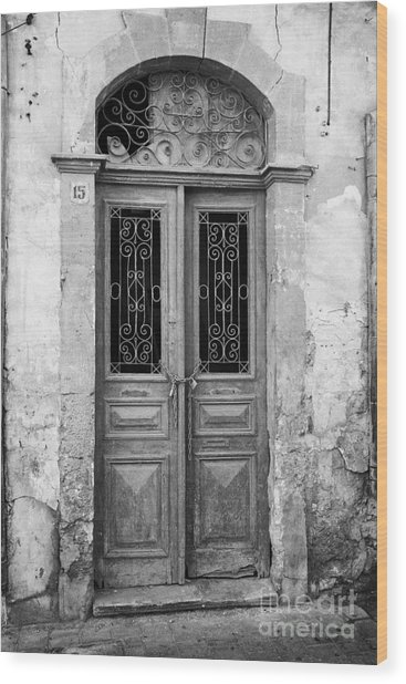 chained up wooden door to derelict house near the restricted area of the UN buffer zone Wood Print by Joe Fox