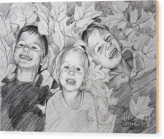 Children Playing In The Fallen Leaves Wood Print