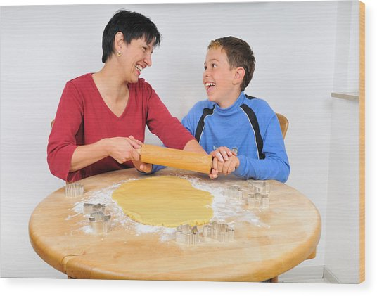 Christmas Baking - Mother And Son Laughing Wood Print by Matthias Hauser