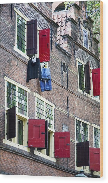Clothes Hanging From A Window In Kattengat Wood Print