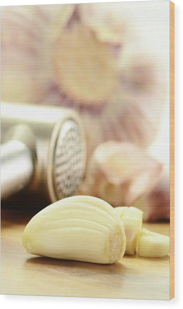 Composition With Fresh Garlic On Breadboard Wood Print by T Monticello