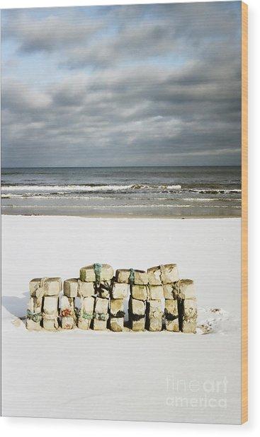 Concrete Bricks On A Snowy Beach Wood Print