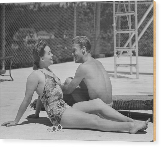 Couple At Poolside Wood Print by George Marks