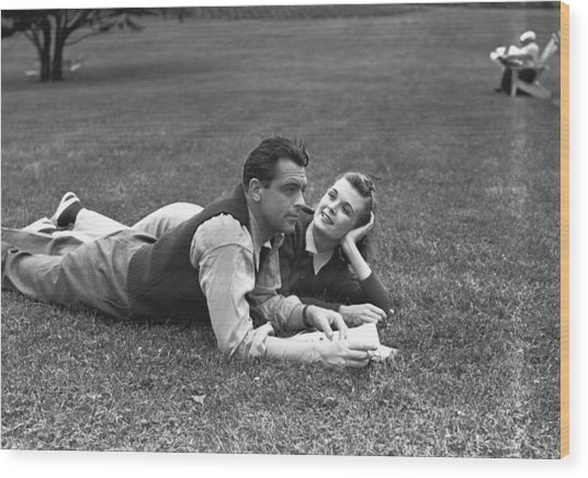 Couple Lying On Grass, (b&w) Wood Print by George Marks