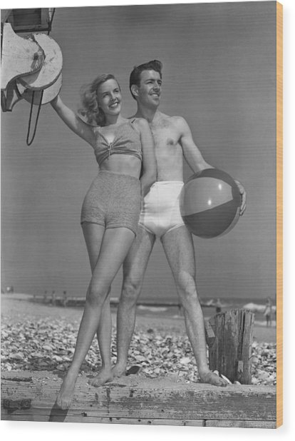Couple On Beach W/beach Ball Wood Print by George Marks