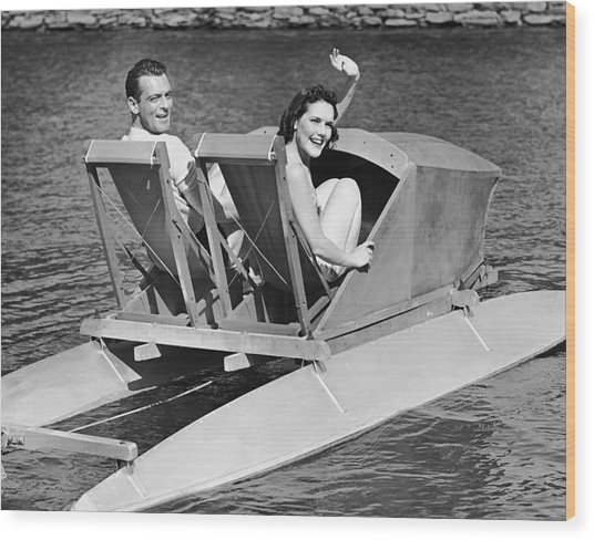 Couple On Lake In Paddle Boat Wood Print by George Marks