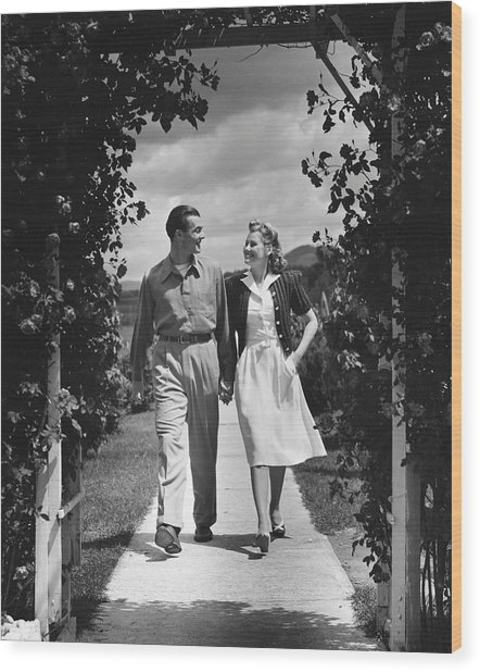 Couple Outdoors Holding Hands While Walking Wood Print by George Marks