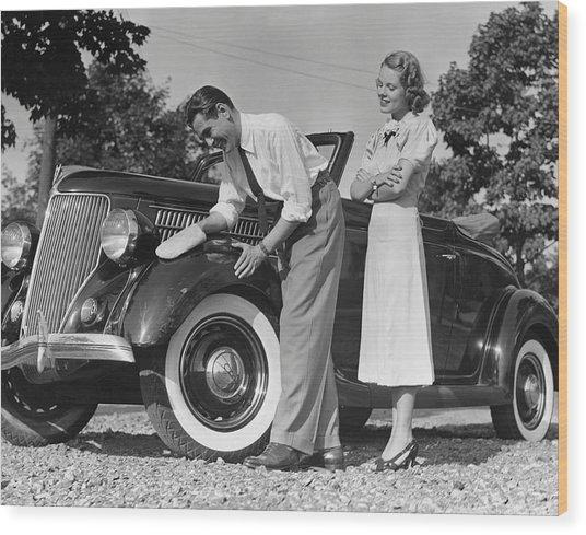 Couple Polishing Car Wood Print by George Marks