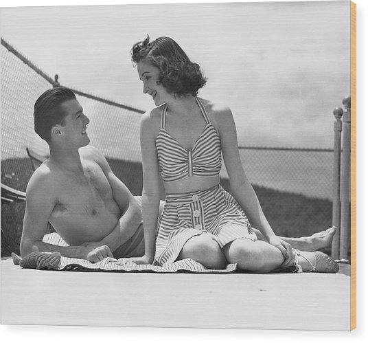 Couple Relaxing On A Sailboat Wood Print by George Marks