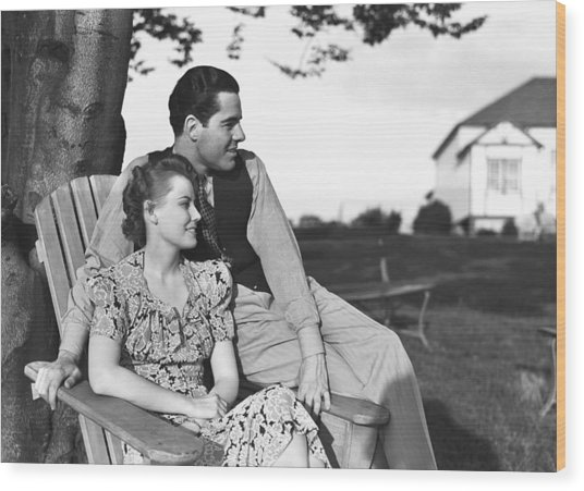 Couple Relaxing On Deckchair In Garden, (b&w) Wood Print by George Marks