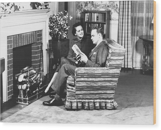 Couple Sitting On Armchair In Front Of Fireplace, (b&w) Wood Print by George Marks
