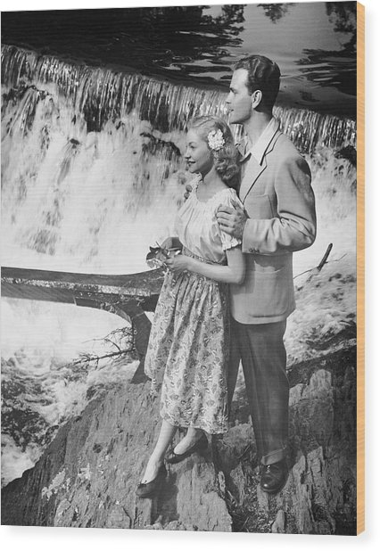 Couple Standing Near Waterfall Wood Print by George Marks