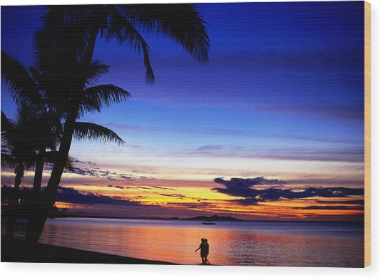 Couple Walking Along Beach At Sunset, Fiji Wood Print by Peter Hendrie