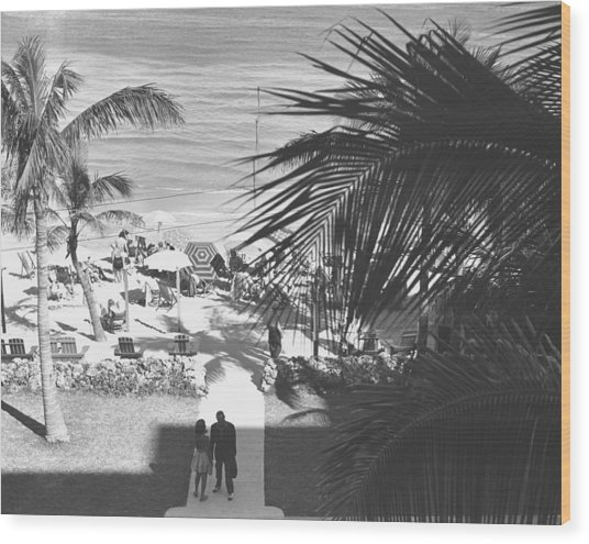 Couple Walking In Path Towards Beach, (b&w), Elevated View Wood Print by George Marks