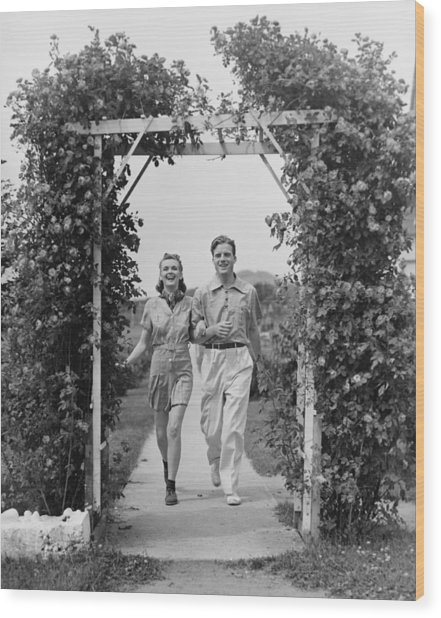 Couple Walking On Footpath Towards Rose Covered Pergola, (b&w) Wood Print by George Marks
