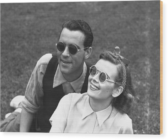 Couple Wearing Sunglasses Sitting On Grass, (b&w) Wood Print by George Marks