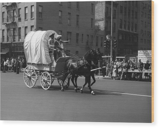 Covered Wagon On Street During Parade Wood Print by George Marks