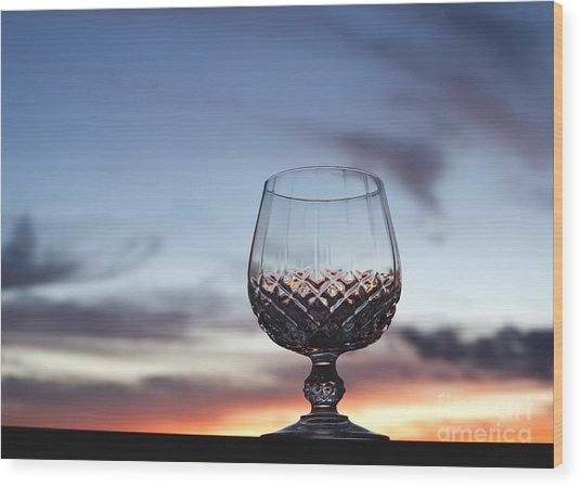 Crystal Glass Against Sunset Wood Print