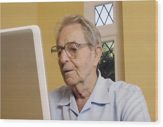 Elderly Man Using A Laptop Computer Wood Print by Steve Horrell