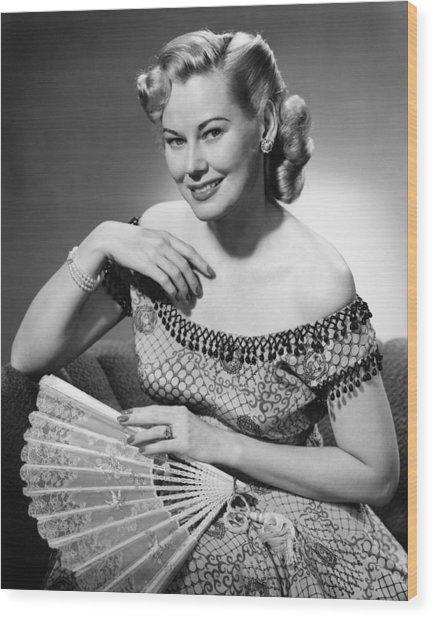 Elegant Woman Holding Fan Posing In Studio, (b&w), Portrait Wood Print by George Marks