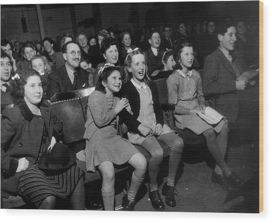 Enthralled Audience Wood Print by Kurt Hutton
