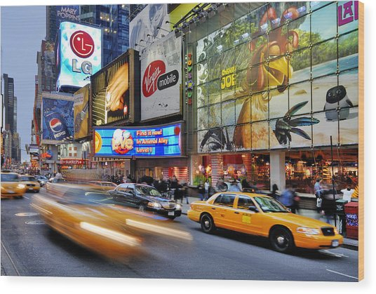 Evening Traffic At Times Square Wood Print by Izzet Keribar