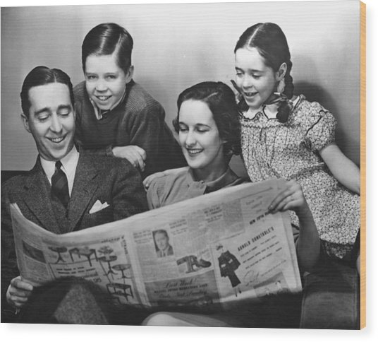 Family Reading Newspaper Wood Print by George Marks