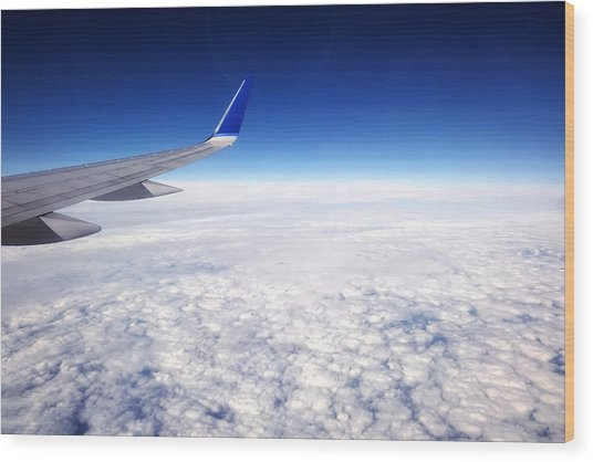 Flying Above The Clouds Wood Print