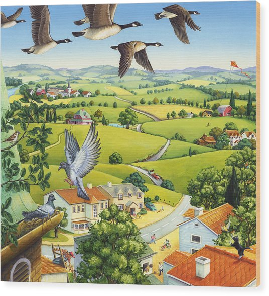 Geese Above The Town Wood Print