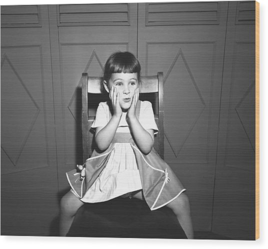 Girl (5-5) Sitting Astride Chair, Making Face, (b&w), Wood Print by George Marks