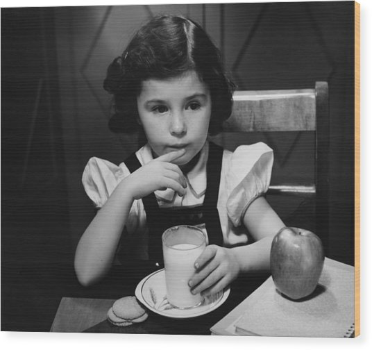 Girl (6-7) Sitting At Table, Having Breakfast, (b&w) Wood Print by George Marks