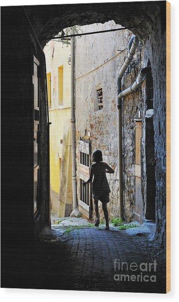 Girl Running Through A Cobblestone Street Wood Print by Sami Sarkis