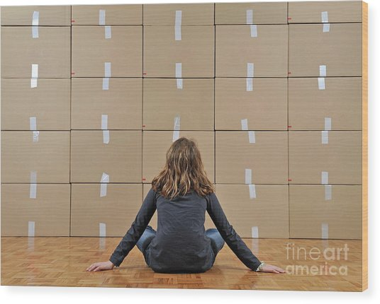 Girl Seated In Front Of Cardboard Boxes Wood Print by Sami Sarkis