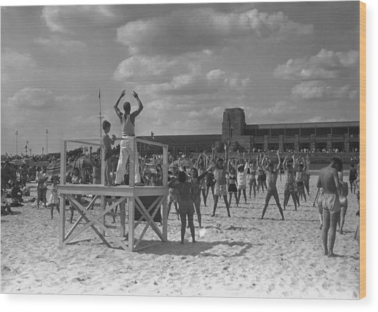 Group Of People Exercising On Beach, (b&w) Wood Print by George Marks